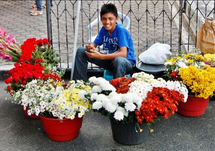 Photography Patrol – Young Man Sells Flowers at the Santo Nino Church in Tacloban City–Photos by Samuel E. Warren Jr.
